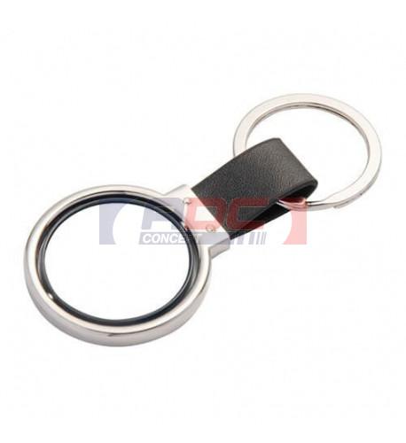 Porte-clé rotatif en métal argenté et cuir 3,7 x 9 cm avec 2 plaques alu Ø 3 cm (vendu à l'unité)