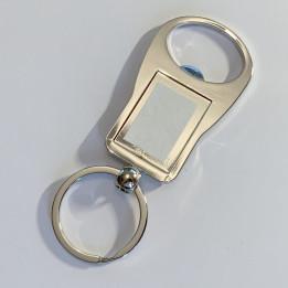 Porte-clé décapsuleur en métal argenté ovale 3,5 x 9,5 cm (vendu à l'unité)